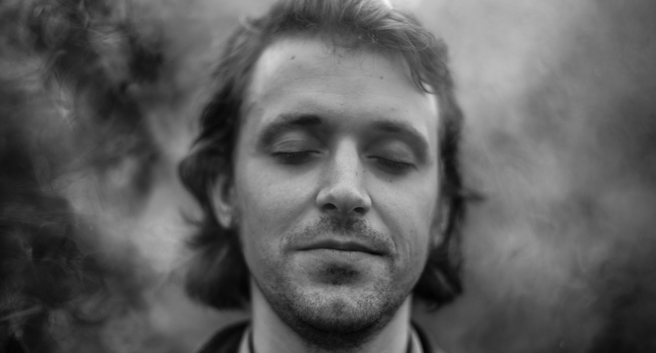 Monochrome image of man with eyes closed