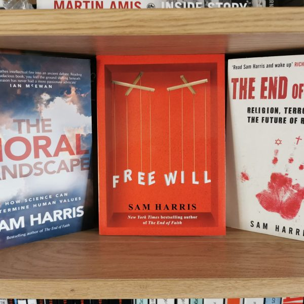 Free Will by Sam Harris on a shelf alongside other novels by the author
