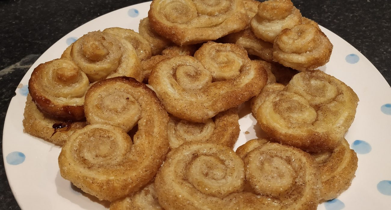 goden palmier pastries on a plate