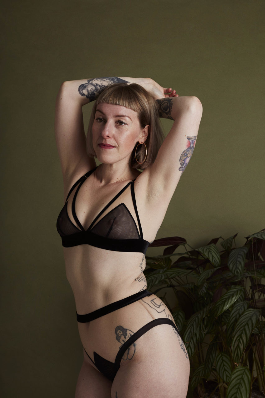 Woman modelling black lingerie set from The Underargument