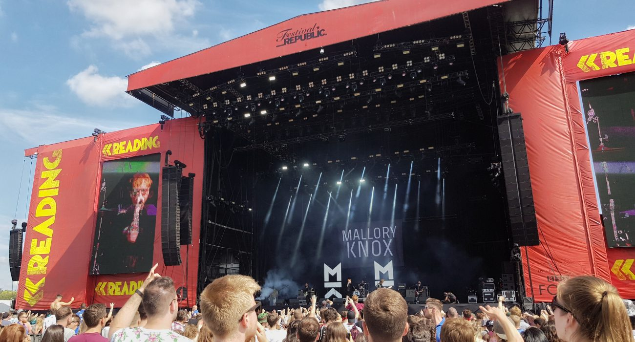 Red stage set up at Main Stage, Mallory Knox performing.