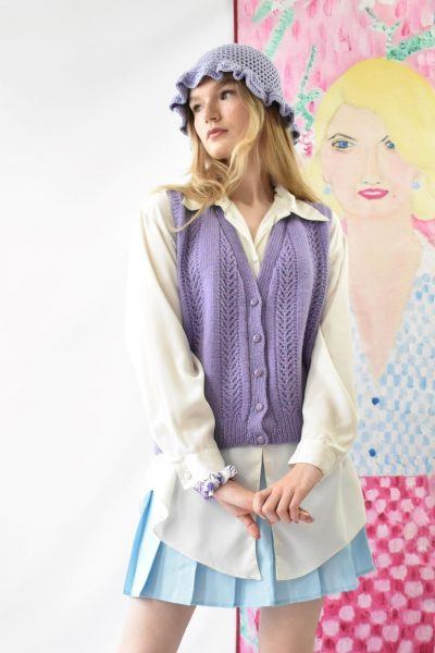 Woman wearing lilac button down vintage sweater vest with shirt