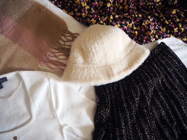 Cream jumper, pleated maxi skirt, floral dress, scarf and fur bucket hat from Primark