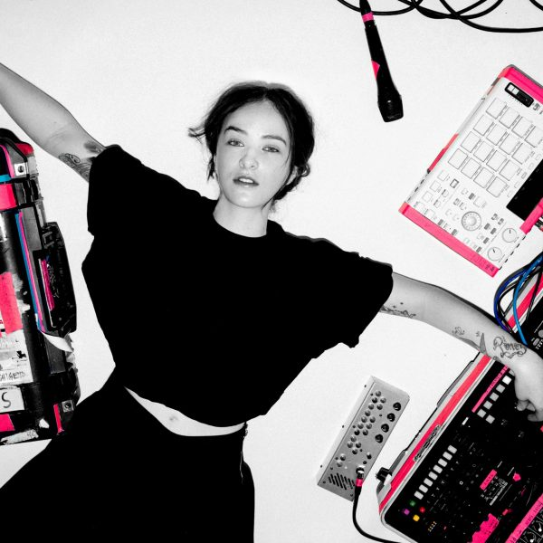 Electro-pop and monochromatic image of Ela Minus amongst her synthesizers.
