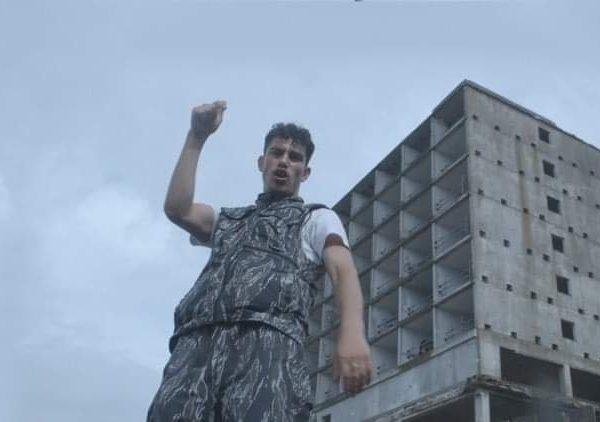 Grime artist Geoblu foreground a grey sky and skyline