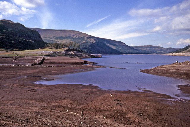 Haweswater Reservoir at a low water level, mud flats are visible
