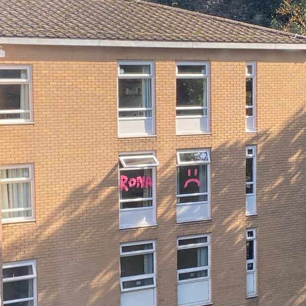 Isolating students have put signs in their windows to let others know they have the virus. Photo: Carlo Di Giammarino