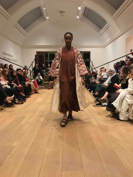 Model walking down catwalk showcasing design