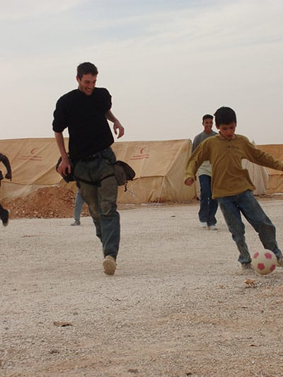 Tom plays football with children at the Al-Rweished Refugee Camp, Jordan, 30th March 2003. Photo: Tom Hurndall