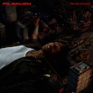 Artist Pa Salieu lies amongst a darkly lit cityscape