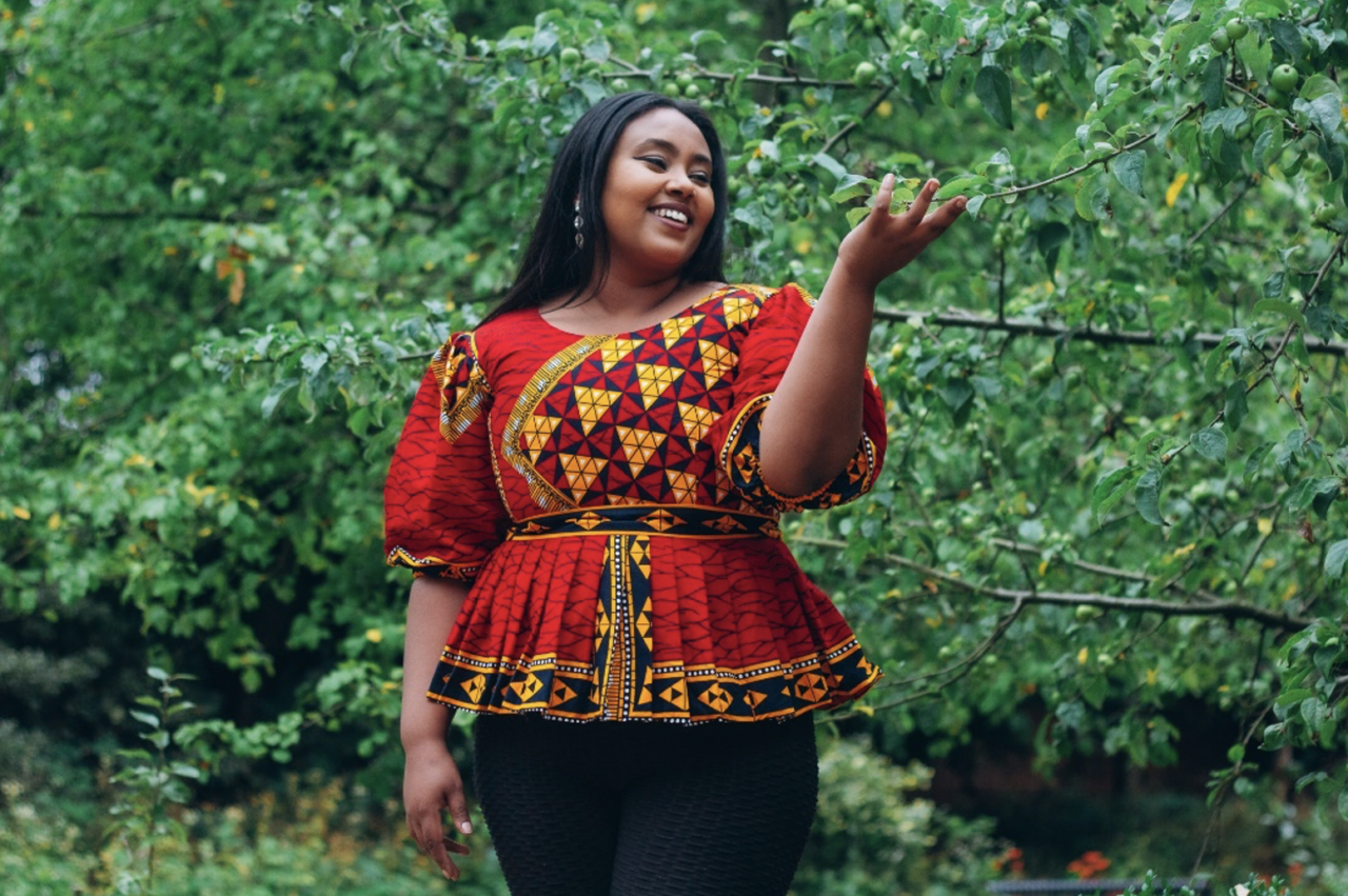 Photo of a black women modelling a garment with a Cultureville print