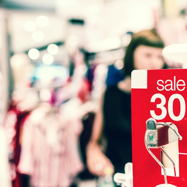 Clothing rail for sale sign Photo: Artem Beliaikin @ Unsplash