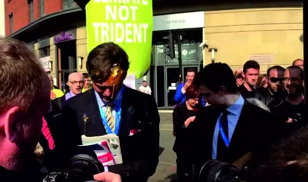 An altercation with anti-government protesters culminated in Colm taking an egg to the face, and his face appearing on the front pages the next day. Photo: chunkymark @ YouTube