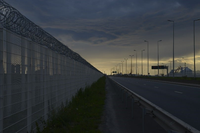 A £7 million fence separates those fleeing persecution and their hope for a better life. Photo: Daniel Saville