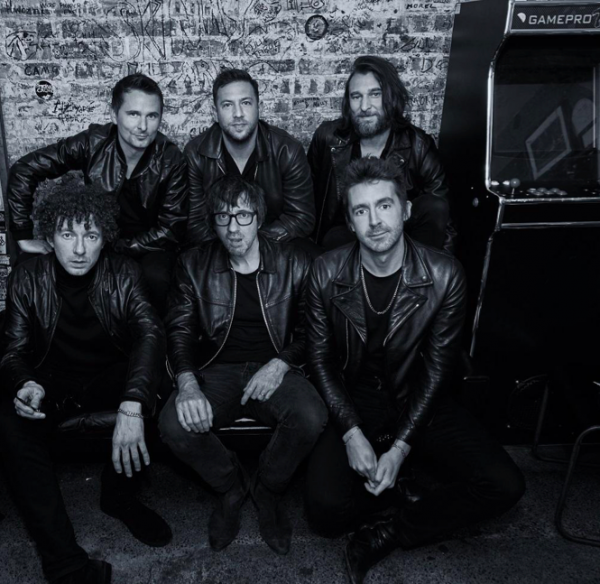Black and White photograph displays music supergroup, The Jaded Hearts Club