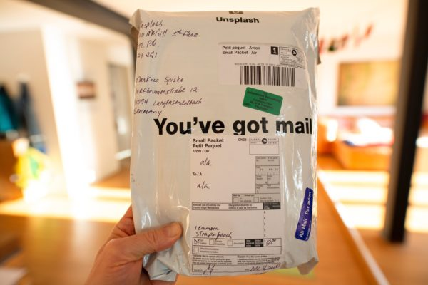 Image of a hand holding a package reading 'you've got mail'