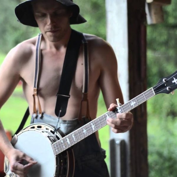 banjo player in woodland backdrop of steve N Seagulls youtube sensation video