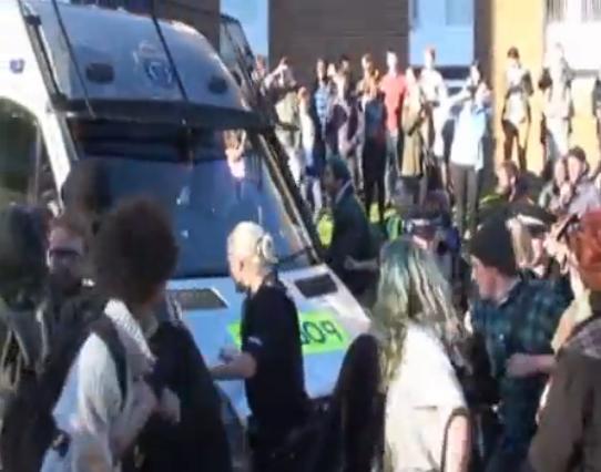 Weatherley is escorted off campus in a police van.