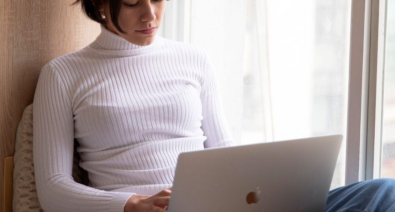Woman using laptop in loungewear