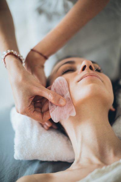 woman using gua share skincare massage